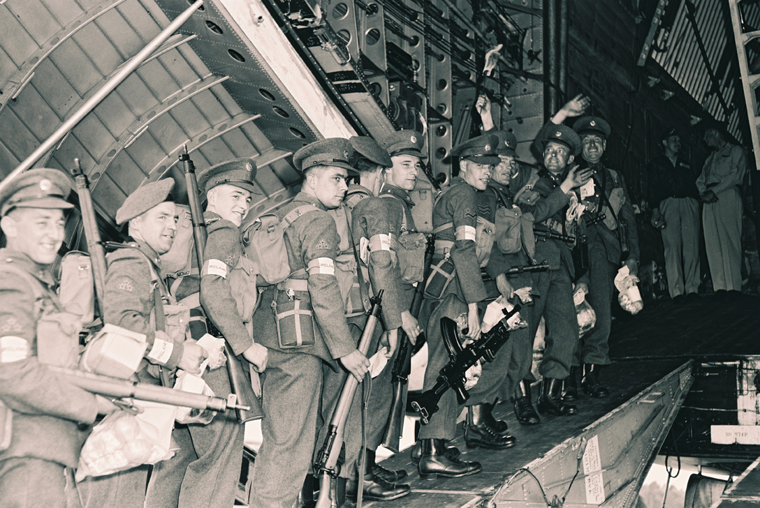 The photograph shows Defence Forces personnel boarding a US Globemaster transport aircraft for the Congo in the early 1960s armed with the Lee Enfield Rifle