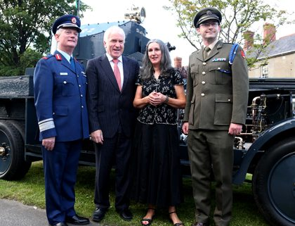 Maj. Gen. Ralph James (DCOS Ops), Minister Deenihan, Ms. Caitriona Crowe (National Military Archives) and Comdt. Padraig Kennedy (OIC Archives) in front of AAR 2 'Sliabh na mBan' (the 'Michael Collins armoured car)..