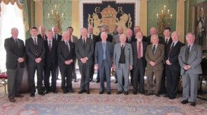 Our photograph shows the Trust Chairman Gen Paddy Nowlan with Gen Trousdell in the company of Trust Directors and members of the Royal Irish Regimental Association.